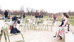 PARIS, FRANCE - DECEMBER, 31, 2016. Asian wedding photographer at work. Chinese couple posing in the Parisian park Royalty Free Stock Photography