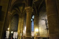 Side aisle of the Notre-Dame cathedral in Paris, France. stock image