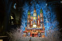 Nativity scene for Christmas holidays inside the Notre-Dame cathedral in Paris, France. Paris/France - December 8, 2015: Beautiful nativity scene inside stock photos