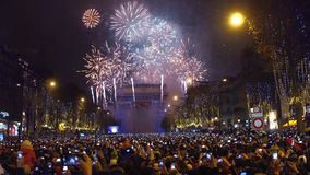 PARIS, FRANCE - DECEMBER, 31. Beautiful New year fireworks above famous triumphal arch, Arc de Triomphe. Tourists. Shooting videos and photos with their mobile stock footage