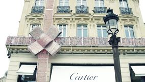 PARIS, FRANCE - DECEMBER, 31, 2016 Big gift-like decorated Cartier luxury store royalty free stock photo