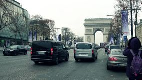 PARIS, FRANCE - DECEMBER, 1, 2017. Champs-Elysees street and famous triumphal arch, Arc de Triomphe. Woman making photo. With her mobile phone. 4K clip stock video footage