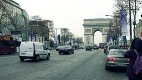 PARIS, FRANCE - DECEMBER, 1, 2017. Champs-Elysees street and famous triumphal arch, Arc de Triomphe. Woman making photo Royalty Free Stock Photo