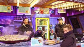 PARIS, FRANCE - DECEMBER, 31. Christmas and New Year market fastfood stall vendors. Traditional foie gras sandwiches. PARIS, FRANCE - DECEMBER, 31. Christmas and Stock Photo