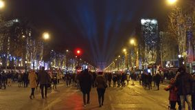PARIS, FRANCE - DECEMBER, 31, 2016. Crowded Champs-Elysees street and famous triumphal arch Arc de Triomphe. New Year`s Stock Images