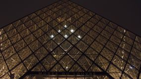 PARIS, FRANCE - DECEMBER, 31, 2016. Louvre entrance at night. Famous French museum and popular touristic destination. PARIS, FRANCE - DECEMBER, 31, 2016 Louvre Stock Image