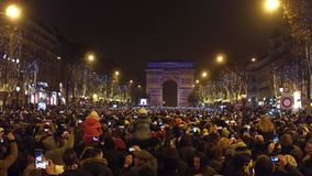 PARIS, FRANCE - DECEMBER, 31, 2016. Overhead shot of crowded Champs-Elysees street and light show on famous triumphal. Arch, Arc de Triomphe stock photography