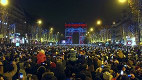 PARIS, FRANCE - DECEMBER, 31, 2016. Overhead shot of crowded Champs-Elysees street and light show on famous triumphal. Arch, Arc de Triomphe. New Year eve. 4K stock video footage