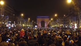 PARIS, FRANCE - DECEMBER, 31, 2016. Overhead shot of crowded Champs-Elysees street and light show on famous triumphal. Arch, Arc de Triomphe. New Year eve. 4K stock footage
