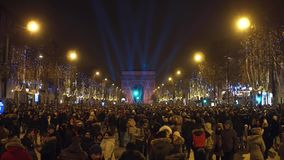 PARIS, FRANCE - DECEMBER, 31, 2016. Overhead shot of crowded multiethnic Champs-Elysees street on New Year`s eve. PARIS, FRANCE - DECEMBER, 31, 2016. Overhead stock photo