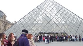 PARIS, FRANCE - DECEMBER, 31, 2016. People standing in line to enter the Louvre, famous French museum and popular Stock Photography