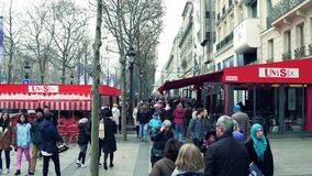 PARIS, FRANCE - DECEMBER, 31, 2016. People walk on famous French Champs-Elysees street. PARIS, FRANCE - DECEMBER, 31, 2016 People walk on Champs-Elysees street stock images