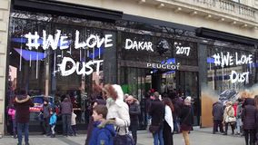 PARIS, FRANCE - DECEMBER, 31, 2016. Peugeot boutique with Dakar 2017 sign on famous French Champs-Elysees street. PARIS, FRANCE - DECEMBER, 31. Peugeot boutique stock photography