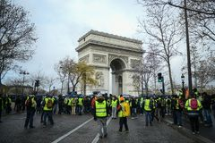 Yellow vests - Gilets jaunes protests - Protester in front of Arc de Triomphe on Champs Elysees royalty free stock image