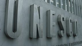 PARIS, FRANCE - DECEMBER, 31. Racking focus shot of UNESCO sign board. 4K close-up video stock video