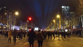 PARIS, FRANCE - DECEMBER, 31, 2016. Steadicam shot of crowded Champs-Elysees street and famous triumphal arch Arc de. Triomphe. New Year`s eve. 4K clip stock footage