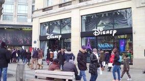 PARIS, FRANCE - DECEMBER, 31, 2016. Steadicam shot of Disney store on famous French Champs-Elysees street. 4K clip. PARIS, FRANCE - DECEMBER, 31, 2016. Steadicam stock video footage
