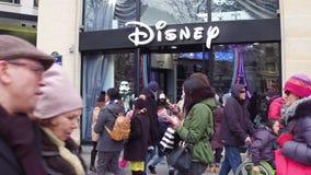 PARIS, FRANCE - DECEMBER, 31, 2016. Steadicam shot of Disney store on famous French Champs-Elysees street. 4K video. PARIS, FRANCE - DECEMBER, 31, 2016 stock video footage