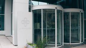 PARIS, FRANCE - DECEMBER, 31, 2016 Steadicam shot of entrance to La Francaise Global Asset Management modern office. Building. 4K establishing video stock video