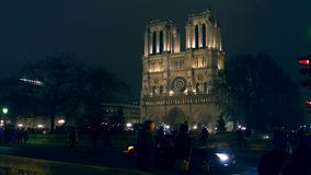 PARIS, FRANCE - DECEMBER, 31, 2016. Steadicam shot of famous Notre Dame cathedral illuminated at night. 4K clip stock video