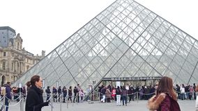 PARIS, FRANCE - DECEMBER, 31, 2016. Steadicam shot of people standing in line to enter the Louvre, famous French museum stock video footage