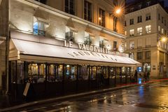 The traditional French brasserie Le Vaudeville at night.It is located near Brogniart palace in Paris, France. Paris,France-17 December 2017: The traditional Stock Images