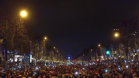 PARIS, FRANCE - DECEMBER, 31. Traditional New year fireworks above famous triumphal arch, Arc de Triomphe. Crowded. Champs-Elysees street. 4K overhead pan clip stock video