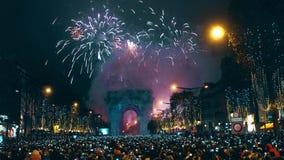 PARIS, FRANCE - DECEMBER, 31. Traditional New year fireworks above famous triumphal arch, Arc de Triomphe. Tourists. PARIS, FRANCE - DECEMBER, 31. Beautiful New stock footage