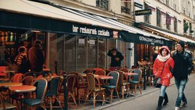 PARIS, FRANCE - DECEMBER, 31, 2016. Walk along beautiful cozy Parisian cafes with awnings. PARIS, FRANCE - DECEMBER, 31, 2016 Walk along beautiful Parisian cafes Royalty Free Stock Photo