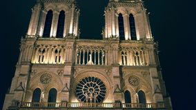 PARIS, FRANCE - DECEMBER, 31, 2016. Western facade of famous Notre Dame cathedral illuminated at night Stock Images