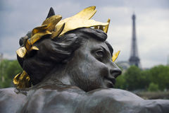 Paris France Eiffel Tower with Statue of Man Gold Crown Royalty Free Stock Photos
