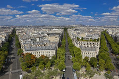 PARIS, FRANCE, EUROPE -Aerial view of Paris, France as seen from the Arch of Triumph on a sunny day with white puffy clouds, shot  Royalty Free Stock Image