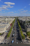 PARIS, FRANCE, EUROPE -Aerial view of Paris, France as seen from the Arch of Triumph on a sunny day with white puffy clouds, shot  Royalty Free Stock Photography