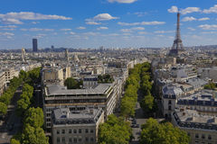 PARIS, FRANCE, EUROPE -Aerial view of Paris, France and Eiffel Tower as seen from the Arch of Triumph on a sunny day with white pu Royalty Free Stock Images