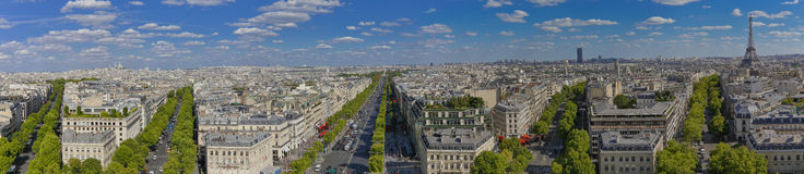 PARIS, FRANCE, EUROPE -Panoramic Aerial view of Paris, France as seen from the Arch of Triumph on a sunny day with white puffy clo Stock Photography