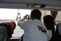 PARIS, FRANCE, EUROPE -Tourist snaps shot of Eifel Tower on cell phone camera -  JULY 24, 2015 Royalty Free Stock Images