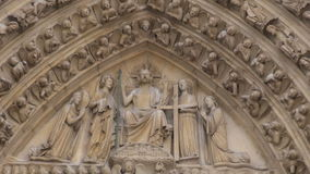 Paris, France - famous Notre Dame cathedral facade saint statues stock video footage