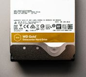 Western Digital Gold HDD disk drive 12 tb detail of. PARIS, FRANCE - FEB 15, 2018: Detail of the New Western Digital Gold HDD enterprise level 12 terabytes disk Royalty Free Stock Photography