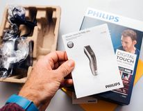 Philips Hair Clipper Series 9000 Professional digital clipper u. PARIS, FRANCE - FEB 14, 2018: Man unboxing Philips Hair Clipper Series 9000 Professional digital stock images