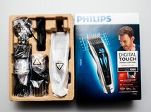 Philips Hair Clipper Series 9000 Professional digital clipper. PARIS, FRANCE - FEB 14, 2018: Man unboxing Philips Hair Clipper Series 9000 Professional digital royalty free stock image