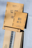 Paris, France - February 08, 2017: Amazon Prime Parcel Package in front the door of a house. Amazon, is an American electronic com Stock Photos