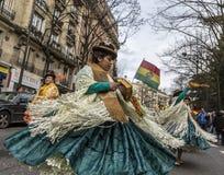 Street Bolivian Girl Dancers - Carnaval de Paris 2018. Paris, France - February 11,2018: Bolivian female dancers performing in the street during the Carnaval de Stock Photo