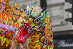 Chinese Dragon - Chinese New Year Parade, Paris 2018. Paris,France-February 25,2018: Detail of the traditional Chinese Dragon performing in the street during the Royalty Free Stock Photos