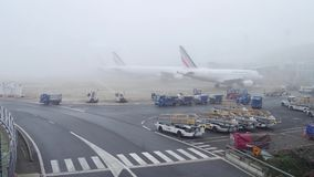 PARIS, FRANCE - JANUARY, 1, 2017. Air France Airbus planes on aircraft parking at Charles de Gaulle airport on a foggy