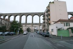 Aqueduct in Arcueil-Cachan, Paris, in the morning. Paris, France-January 21, 2018: The aqueduct between the towns Arcueil and Cachan on the South of Paris, built Stock Image