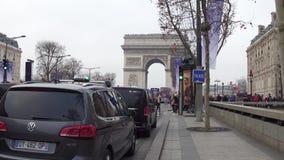 PARIS, FRANCE - JANUARY, 1, 2017. Champs-Elysees street traffic and famous triumphal arch, Arc de Triomphe. 4K video. PARIS, FRANCE - JANUARY, 1, 2017. Champs stock video