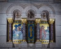 Mosaic representing scenes of the Via Crucis inside the sacred h. Paris, France - January 5, 2018: Mosaic representing scenes of the via crucis inside the church Royalty Free Stock Photo