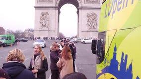 PARIS, FRANCE - JANUARY, 1, 2017. Multinational tourists making photos near famous triumphal arch, Arc de Triomphe. 4K. Video stock video