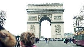 PARIS, FRANCE - JANUARY, 1, 2017. Steadicam shot of tourists making selfie near famous triumphal arch, Arc de Triomphe. 4K clip stock video