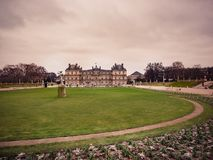 View of the Luxembourg palace, inside the public garden of Luxembourgh, one of the largest in Paris. Paris, France - January 7, 2018: View of the Luxembourg stock images